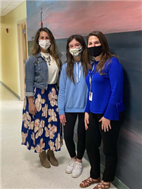 Two Teachers and a Student Standing For Photo In The Hallway thumbnail183209
